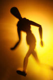 Figure in motion. Blurry silhouette of a figure in motion Stock Photo
