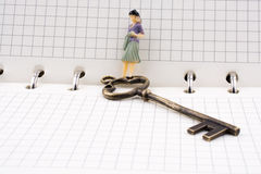 Figure near a key on a notebook Royalty Free Stock Photography
