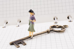 Figure near a key on a notebook Stock Photography