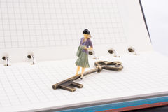 Figure near a key on a notebook Royalty Free Stock Image