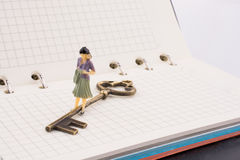 Figure near a key on a notebook Stock Photo