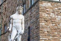Figure of Neptune and wall of Palazzo Vecchio Stock Images