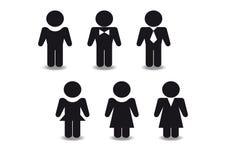 Figure nere stilizzate degli uomini e delle donne Fotografia Stock