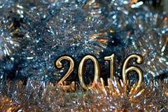 Figure 2016 (nuovo anno, Natale) nelle luci intense Fotografia Stock