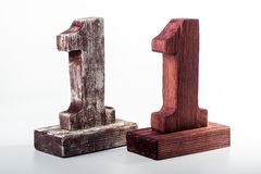 Two digits one of wood. Figure one mahogany wood with white paint Royalty Free Stock Image