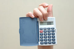 The figure is out. Woman hand holding a calculator with an lucky number Royalty Free Stock Photos