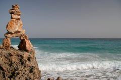 Figure par la mer Photos libres de droits