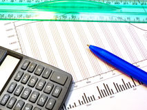 Figure, pen, ruler and calculator Stock Photos