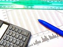 Figure, pen, ruler and calculator Stock Photos