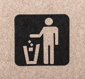 Figure of person throwing garbage into a trash can. Figure of person throwing garbage into a trash can royalty free stock image