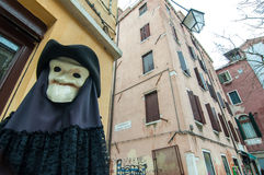 Figure with plague mask and costume in Venice. Figure with plague mask and dark costume in Venice Stock Images