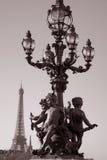 Figure on Pont Alexandre III Bridge, Paris. Figure on Pont Alexandre III Bridge with the Eiffle Tower in the Background; Paris; France Stock Photos