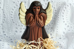 Figure of prayed  chocolate angel Royalty Free Stock Image