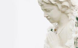 Figure of a praying angel Stock Photos