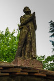 Figure of praying monk on the gate leading to the cemetery, the. Nuns of the Benedictine abbey, Staniatki near Krakow in Poland stock photo