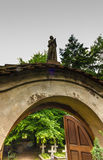 Figure of praying monk on the gate leading to the cemetery, the. Nuns of the Benedictine abbey, Staniatki near Krakow in Poland royalty free stock photo