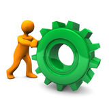 Figure pushing gear cog Royalty Free Stock Photography
