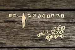 Figure que las tejas imposibles de la letra que se zambullen firman en posible Imagenes de archivo