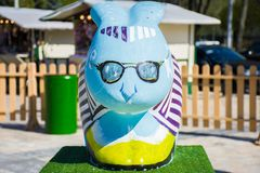 The figure of a rabbit with a foreground in blue and glasses on his face . Beautiful Easter decoration stock photos