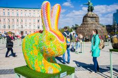 The figure of a rabbit or hare in the guise of the chameleon against the background of monument to Bohdan Khmelnytskyi. Beautiful. Easter decoration art stock photo