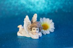 The figure of a resting angel. stock photo