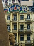 Figure of sand on the background of the old buildings. Karlovy vary. Czech Republic 2017 Royalty Free Stock Image