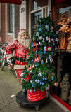 Figure of Santa Claus and Christmas tree Royalty Free Stock Photo