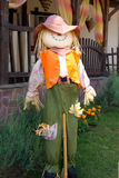 Figure scarecrow a waistcoat and hat Royalty Free Stock Image