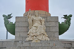 Figure of sea goddess at Rostral Column on Exchange Square on Vasilyevsky Island in Saint Petersburg, Russia Royalty Free Stock Images