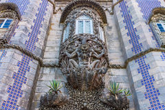 Figure of sea monster in a wall, Palacio da Pena. Carved stone figure of a sea monster in a wall at the Palacio da Pena, Sintra, Portugal. Pena National Palace Stock Photo