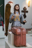 Figure of a seated angel from the collection of the Perm wooden. PERM, RUSSIA-MARCH 26, 2017: Wooden figure of an angel from the collection of wooden sculpture Royalty Free Stock Photos