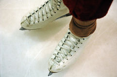 Figure skater. A pair of figure skates on ice stock images