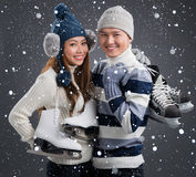 Figure skaters. Portrait of a couple of figure skaters smiling and looking at camera Royalty Free Stock Photos