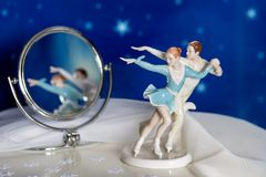 Figure skaters with reflection in a mirror. On a starry background Royalty Free Stock Photo