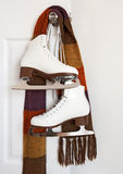 Figure skates and colourful scarf Royalty Free Stock Image