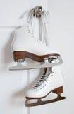 Figure skates hanging on a door knob Stock Photos