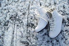 Figure skates on ice Stock Image