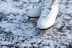 Figure skates on ice Stock Photo