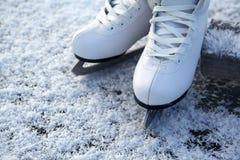 Figure skates on ice Royalty Free Stock Image