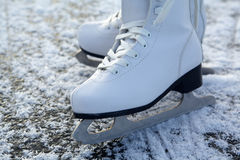 Figure skates on ice Stock Photo
