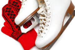 Figure skates and mittens Stock Images