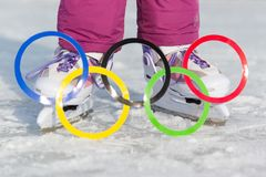 Russia, Yasny city, Orenburg region, school ice rink, 12-10. Olympic rings against the backdrop of ice skates. Figure skating, sports at the Winter Olympics Stock Images