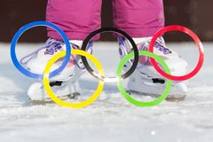 Russia, Yasny city, Orenburg region, school ice rink, 12-10. Olympic rings against the backdrop of ice skates. Figure skating, sports at the Winter Olympics Stock Image