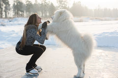 Figure skating woman with dog Samoyed Stock Photos