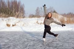 Figure skating woman at the frozen lake Royalty Free Stock Photography