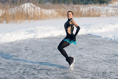 Figure skating woman at the frozen lake Royalty Free Stock Image