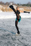 Figure skating woman at the frozen lake Stock Photos