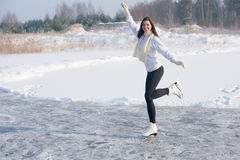 Figure skating woman at the frozen lake Stock Image