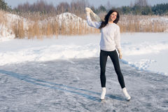 Figure skating woman at the frozen lake Royalty Free Stock Photo