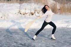 Figure skating woman at the frozen lake Royalty Free Stock Image